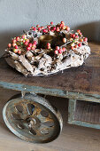 Wreath of burl wood and crab apples on trolley