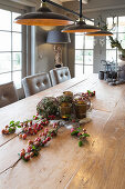 Natural arrangement on wooden table in rustic dining room