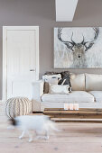 Picture of stag above sofa in cream living room