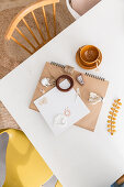 Notebook, finds and knick-knacks on dining table