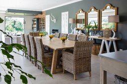 Long table and wicker chairs in dining area