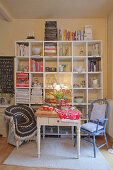 Set dining table in front of shelves of books and crockery