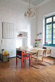 Vintage furniture in dining room with high ceiling and parquet floor