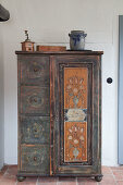 Old, painted farmhouse cabinet with door and four drawers