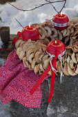 Advent wreath of spherical candles and dried apple rings