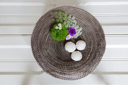 Dish made from corrugated cardboard decorated with natural arrangement of flowers and moss