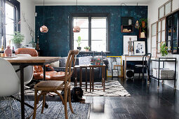 Dark blue walls in eclectic, multifunctional interior