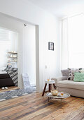 Open doorway from from living room through hall into bedroom