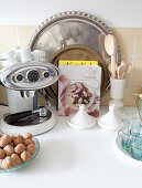 Every day still-life arrangement with coffee machine and trays