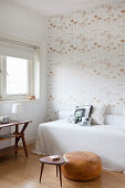 Patterned retro wallpaper in small bedroom in shades of white and brown