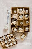 Vintage Christmas-tree baubles in old cardboard box