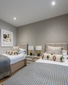 Twin beds in bedroom in shades of grey