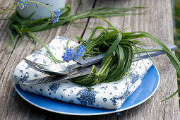 Table decoration with forget-me-nots and salad