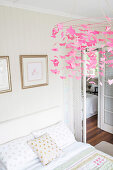 Bright bedroom with double bed, Rosa Mobile above