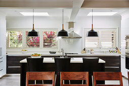 View over the back of a chair to the center block in the open kitchen