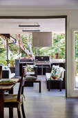 View from the dining area onto the living terrace with outdoor kitchen