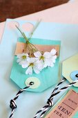 White flowers on hand-made paper tags