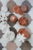 Clay Christmas decorations in white and terracotta on Oriental pattern