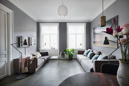 Two sofas facing one another in living room in shades of grey