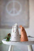 Perforated pottery bells on old white stool