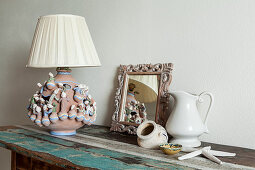 Table lamp with traditional terracotta base and maritime decorations