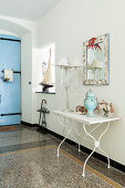 Terrazzo floor and maritime accessories in Mediterranean foyer