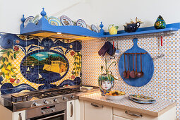 Small Italian kitchen with typically Italian painted tiles