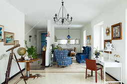 Open-plan, Italian-style interior with blue accents