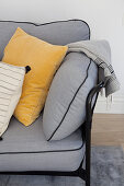 Cushions and blanket on grey sofa