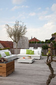 White outdoor furniture on large modern roof terrace
