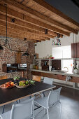 Concrete and metal furniture in industrial-style kitchen-dining room