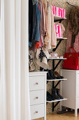 Feminine accessories in walk-in wardrobe in bedroom