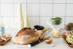 Sliced loaf and bowl of salt on worksurface