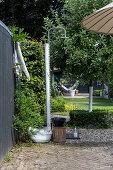 Garden shower on wooden post
