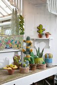 Various crocheted cacti and succulents on veranda