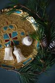Fir branch and old Christmas-tree baubles on tray