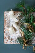 Old Christmas-tree baubles, fir branch and brocade ribbon