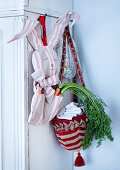 Carrots in hand-made, bunny-shaped cloth bag and basket made from bobble hat