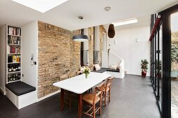 Brick wall and modern benches in dining room