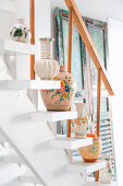 Vases arranged on white staircase