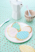 Iced Easter-egg biscuits on plate