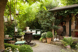 Vintage furniture and potted plants on terrace