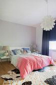 Ombré bed linen in feminine bedroom