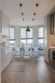 Kitchen-dining room with dining table in window bay