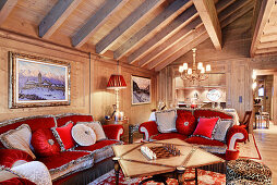 Opulent velvet sofas in red and grey in extravagant living room