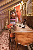 Classic desk in hallway with opulent accessores