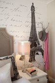 Wallpaper with pattern of French writing in bedroom