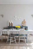 Crumpled tablecloth on table in front of pale grey wall