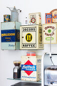 Old tins used as wall-mounted cabinets