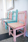 Old children's chairs painted pink and pale blue